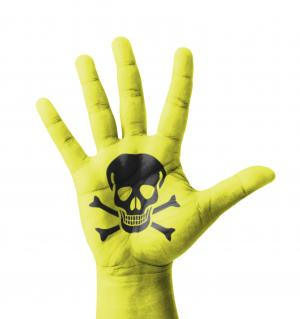 A photo of a green hand with toxic symbol on it.