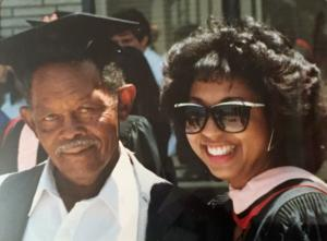 Vanetta Abdellatif poses with her grandfather Prentice Walker as she graduates with a master's degree in public health and health services administration.