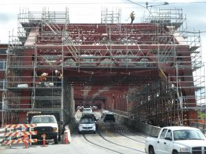 Workers erect scaffolding at the west end of the bridge.