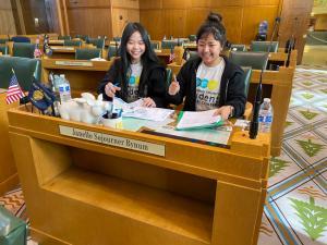 two students preparing a presentation inside Oregon's capitol