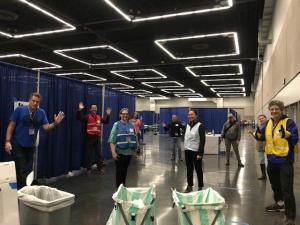 County employees help out at the temporary physical distancing shelter at the Oregon Convention Center.
