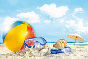 close up of a beach ball and snorkel on a sunny ocean beach