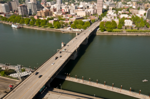 Aerial photo showing the Burnside Bridge, with downtown Portland in the background.