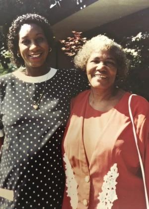 Patricia Charles-Heathers, pregnant with her son Jason, at her doctoral graduation, with her mother Hadassah Chapman.