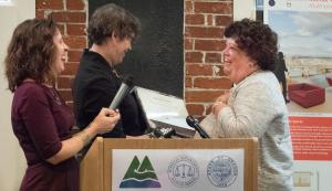 Commissioner Judy Shiprack and Chair Deborah Kafoury present a ceremonial masonry brick to Judge Nan Waller