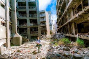 Little girl standing near earthquake debris