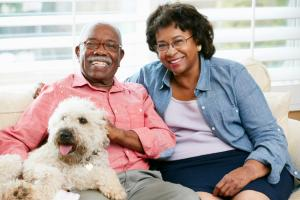happy older couple and their pet dog