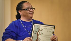 Theresa Dickinson had tears in her eyes while accepting her certificate at the March 5 Milestone Ceremony celebrating DCJ clients who successfully completed 120 days of supervision.