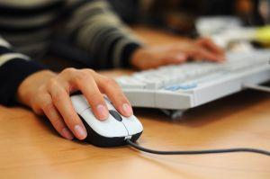 Womans hand on a computer mouse