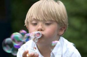 Boy blowing bubble
