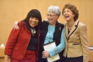 Kathleen celebrates with Commissioners Smith and McKeel.