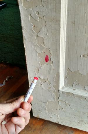 lead test kit showing evidence of lead paint on a door