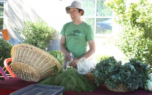 Bryan Allan, the farmer at Zenger Farms in southeast Portland, sets up for the Tuesday Mid County CSA