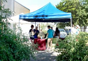 The Zenger Farms CSA sets up in the Mid County parking lot, next to the clinic's own community garden