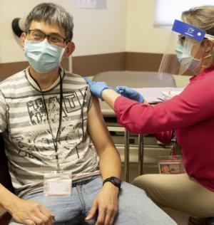person receiving covid vaccine
