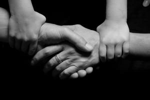 Black and white image of connected hands
