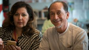 Ronault Catalani, right, leads Portland's efforts to serve immigrants and refugees.
