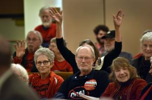 Supporters of Thursday's resolution pack the county board room.