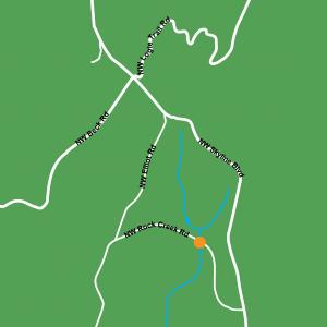 A map showing an orange dot where a creek crosses NW Rock Creek Road.