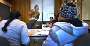 ESL instructor Joshua Clark cups his ear to better hear one of his students at a recent class.