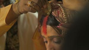applying sindoor powder in a Hindu ceremony