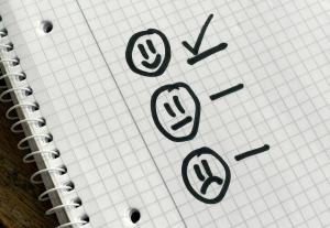 smiley faces on a notepad