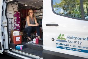 friendly health worker sitting inside a van