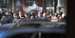 People who use e-cigarettes, own and work at vape shops, gather outside the Multnomah Building before Thursday's board meeting.